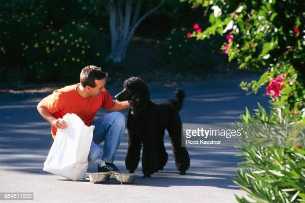 Man Feeding Dog