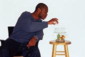 Man feeding goldfish