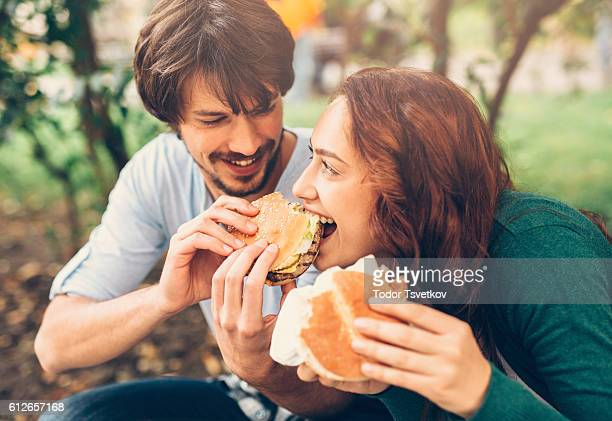 Man feeding his girlfriend