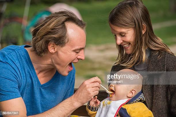 Man feeding his little son