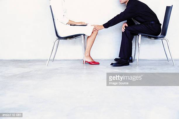 Man feeling a woman up
