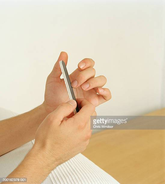 Man filing nails, close-up