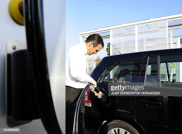 A man fill up his car with biogas fuel a methane gas converted to fuel in the first biogas fueling station in France on October 23 2012 in Morsbach...