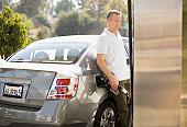 Man filling car at gas station