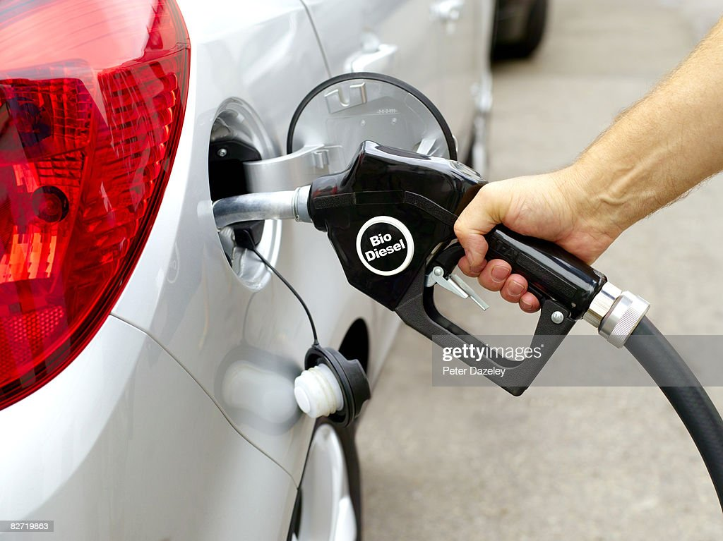 Man filling car with Bio diesel pump