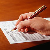 Man filling in application form, Close-up of hand