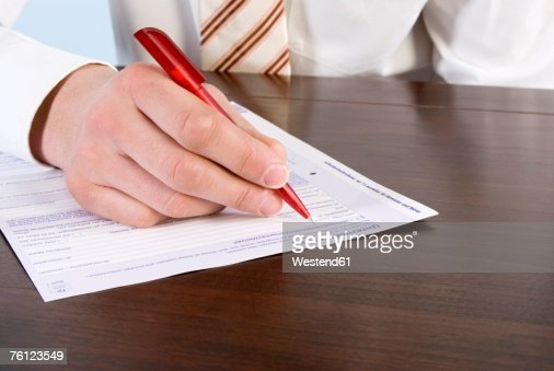 Man filling in form, close-up