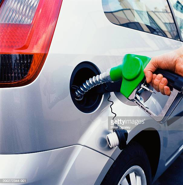 Man filling up car with petrol, close-up