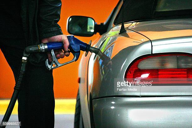 Man filling up his car with petrol 27 July 2005 AFR Photograph by GLENN HUNT