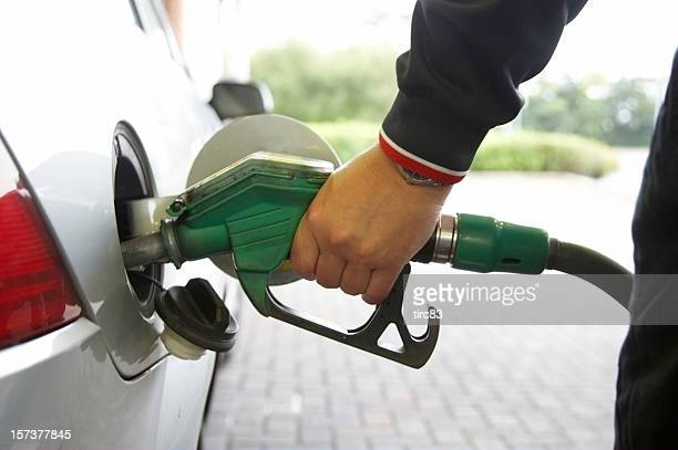 Man filling up the car pump focus