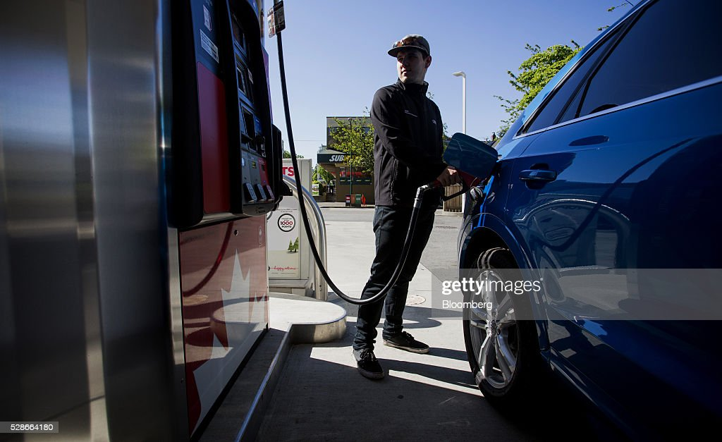 A man fills a car with fuel at a Petro-Canada gas station in Vancouver, British Columbia, Canada, on Friday, May 6, 2016. The worst wildfire in Alberta history is boosting Canadian crude prices as oil companies evacuate workers and shut in output. Photographer: Ben Nelms/Bloomberg via Getty Images