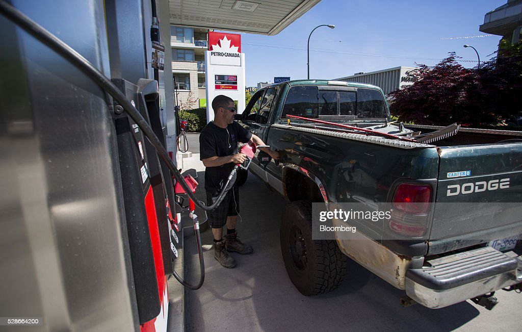 A man fills a truck with fuel at a Petro-Canada gas station in Vancouver, British Columbia, Canada, on Friday, May 6, 2016. The worst wildfire in Alberta history is boosting Canadian crude prices as oil companies evacuate workers and shut in output. Photographer: Ben Nelms/Bloomberg via Getty Images