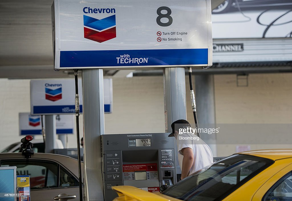A man fills his car with gasoline at a Chevron Corp fueling station in San Francisco California US on Friday April 25 2014 Chevron Corp is expected...