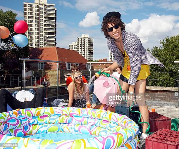 Man fills kiddie pool with water