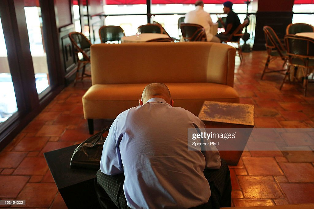 A man fills out an application while waiting to be interviewed for an opening as a cook at the Redeye Grill restaurant, part of the Fireman Hospitality Group, on October 5, 2012 in New York, United States. In fresh signs that the U.S. economy is gaining speed, the latest jobs market data for September showed that the U.S. labor market has improved significantly. The unemployment rate fell from 8.1 percent in August to 7.8 percent in September, moving below 8 percent for the first time in 43 months.