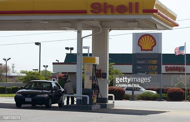 A man fills the gas tank of his car on May 3 2008 at a Shell station in Manassas Virginia With oil prices at record levels sales of new vehicles in...