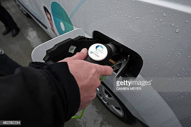 A man fills up his car with hydrogen on January 26 2015 in SaintLo The general council de la Manche inaugurates a new hydrogen station for his cars...