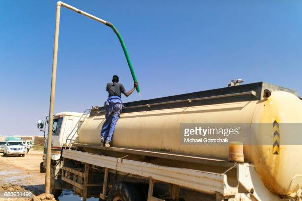 A man fills water for transport into a tanker on April 03 2017 in Kebri Dahar Ethiopia