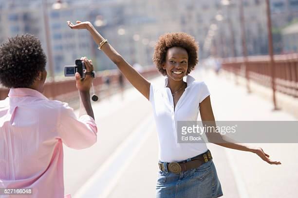 Man Filming on a Bridge