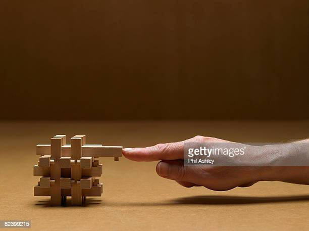 man finishing the last piece of the puzzle