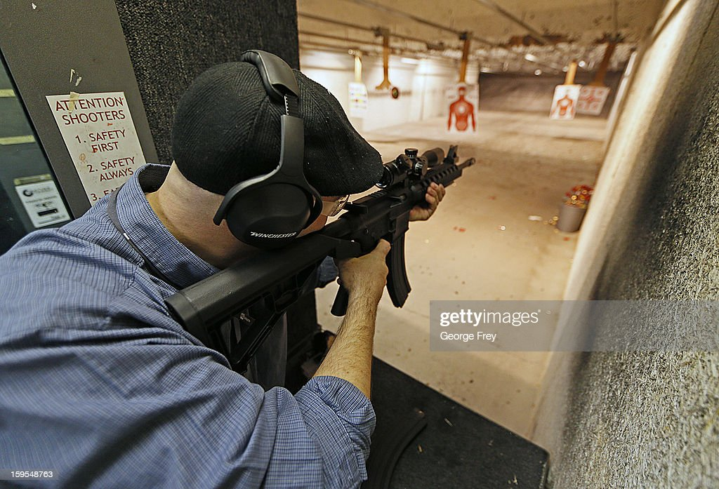 A man fires an 22 Cal. look-alike AR-15 rifle at the 'Get Some Guns & Ammo' shooting range on January 15, 2013 in Salt Lake City, Utah. Lawmakers are calling for tougher gun legislation after recent mass shootings at an Aurora, Colorado movie theater and at Sandy Hook Elementary School in Newtown, Connecticut.