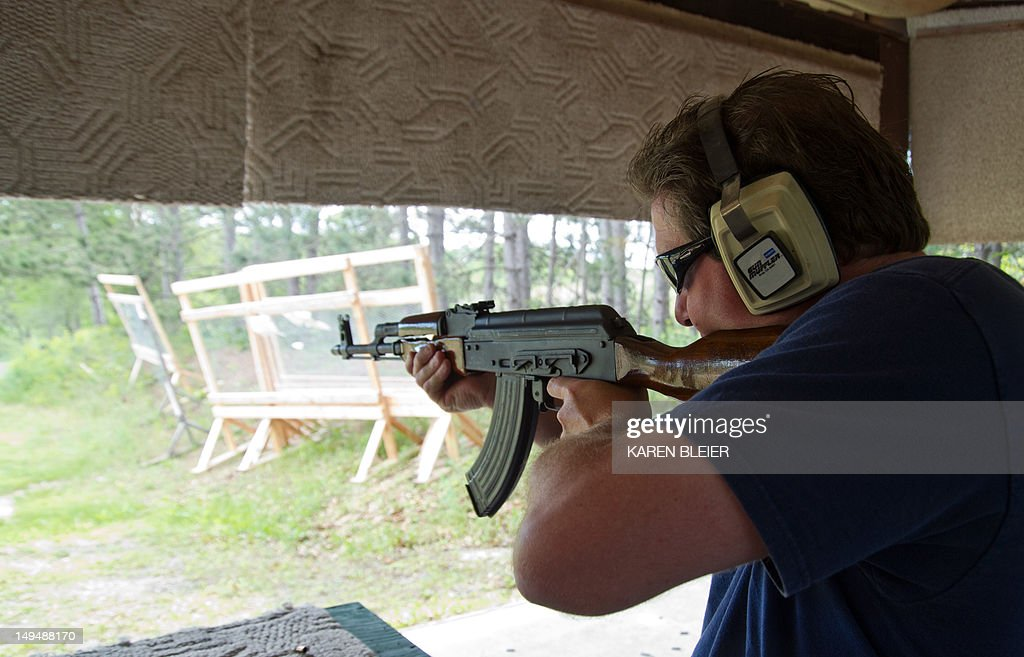 A man fires an AK47 semiautomatic rifle June 3 2012 at the St Croix Rod and Gun Club in Hudson Wisconsin AFP PHOTO/Karen BLEIER