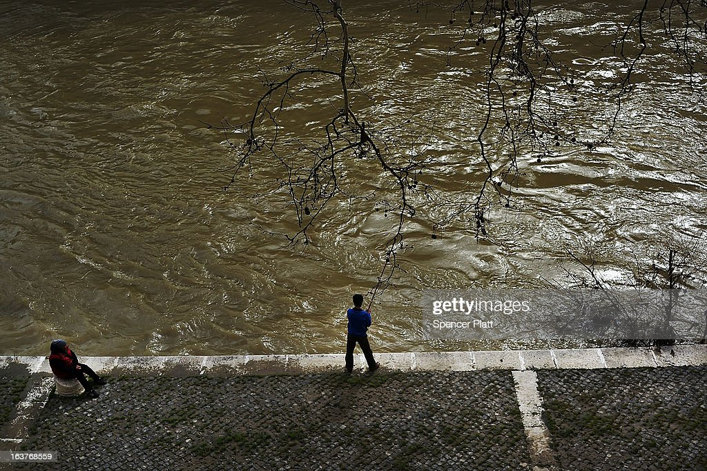 A man fishes along the Tiber River on March 15, 2013 in Rome, Italy. Newly elected Pope Francis, formerly Cardinal Jorge Mario Bergoglio of Buenos Aires, has been a strong advocate for the poor and disenfranchised throughout the world. A Jesuit, Francis has followed the tradition of his order whose members live spartan, communal lives of poverty. Many analysts believe his papacy will see increased outreach and advocacy for the poor.