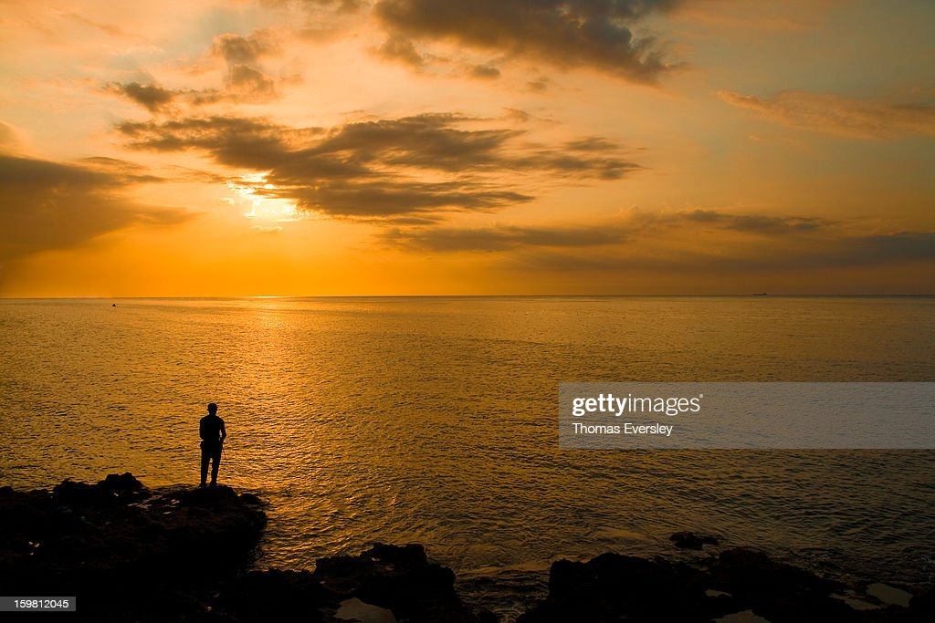 CONTENT] A man fishes at sunset on the Malecón, Havana, Cuba