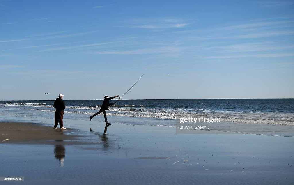 A man fishes at the beach in Atlantic City New Jersey on November 8 2014 For decades Atlantic City was a popular vacation destination with casinos...