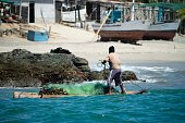 A man fishes from a raft in Cancas Tumbes in northern Peru on July 13 2016 Overfishing has put in risk the subsistence of the 30000 artisanal...