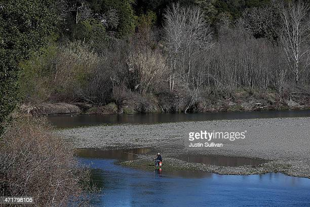 A man fishes from the banks of the Russian River near Healdsburg Veterans Memorial Beach Park on February 21 2014 in Healdsburg California Sonoma...
