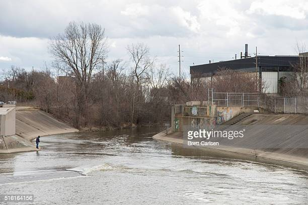 A man fishes in the Flint River the source of the city's water contamination issues on March 17 2016 in Flint Michigan Flint continues to work...