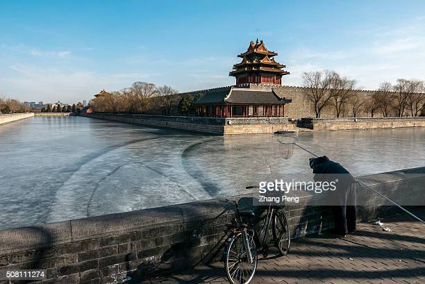 Man fishes on the frozen moat around the Forbidden City China targets economic growth in a range of 65 percent to 7 percent in 2016 The 2016 growth...