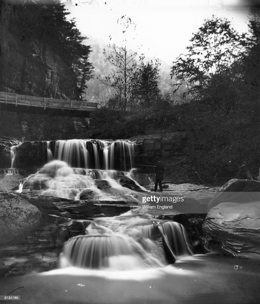 A man fishing at Crystal Cascade in the Catskill Mountains New York State