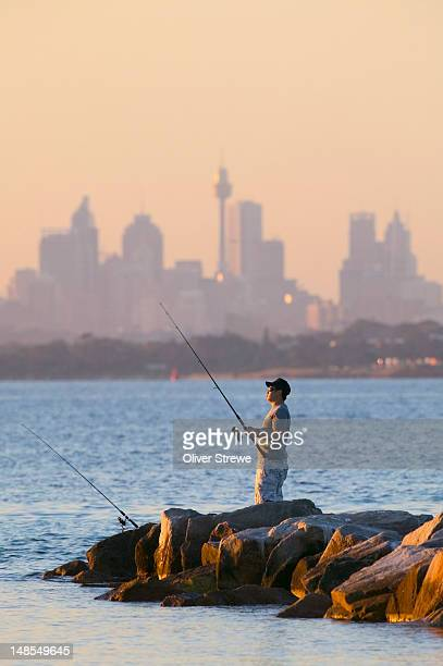 Man fishing at Silver Beach, Botany Bay.