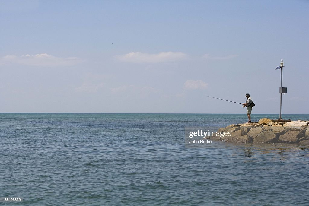 Man fishing from jetty cape cod massachusetts stock photo for Cape cod fishing