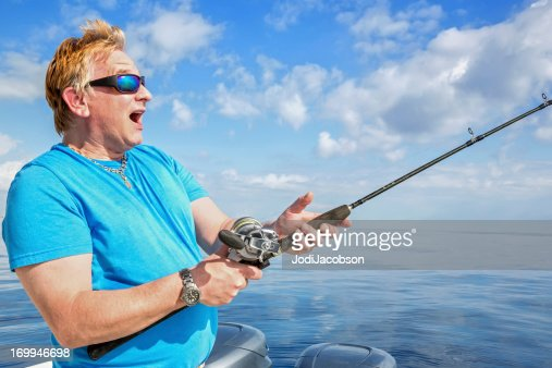 Surprised wave stock photos and pictures getty images for Fat guy fishing