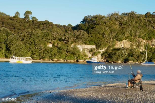 Man fishing in Mercury Bay.