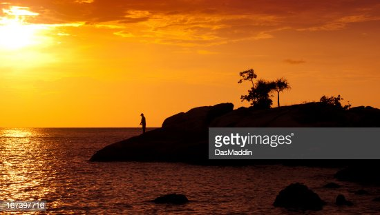 Man fishing in the sunset : Stockfoto