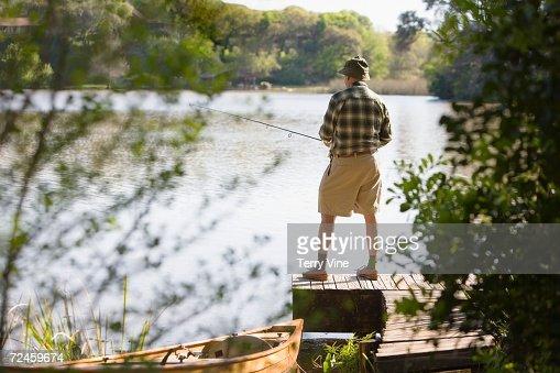 Man fishing on dock : Stock Photo