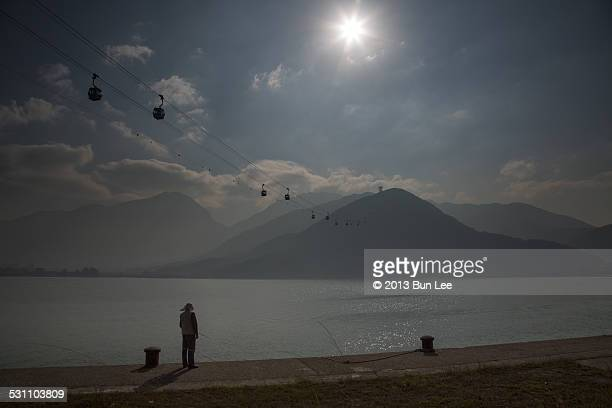 Man Fishing on Sunny Day