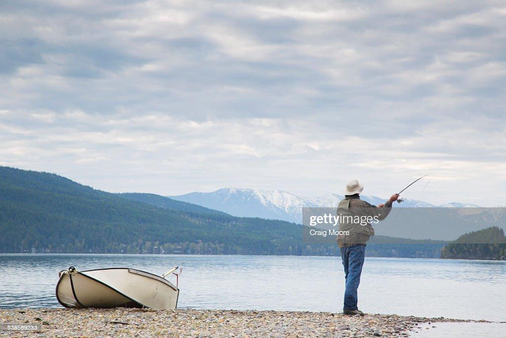 A man fishing on whitefish lake in whitefish montana stock for Whitefish montana fishing