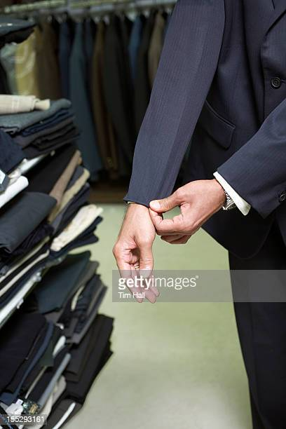 Man fitting business suit in shop