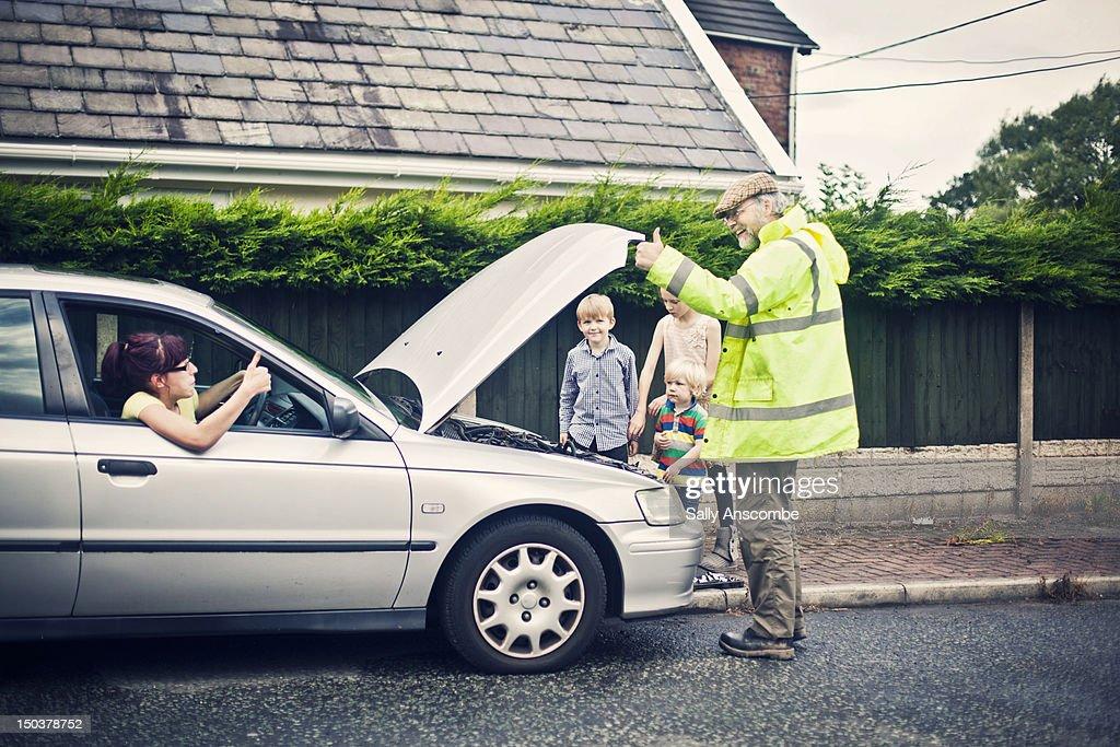 Man fixing car : Stock Photo