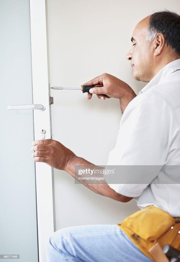 Keywords & Man Fixing Door Stock Photo   Getty Images pezcame.com