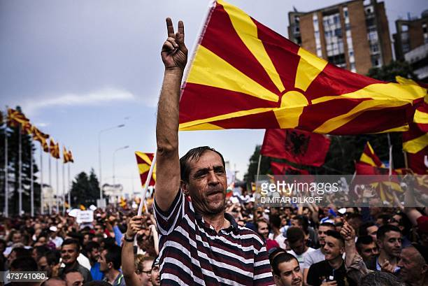 A man flahes the Vsign for victory during an antigovernment protest in downtown Skopje on May 17 2015 More than 20000 people rallied in Macedonia's...