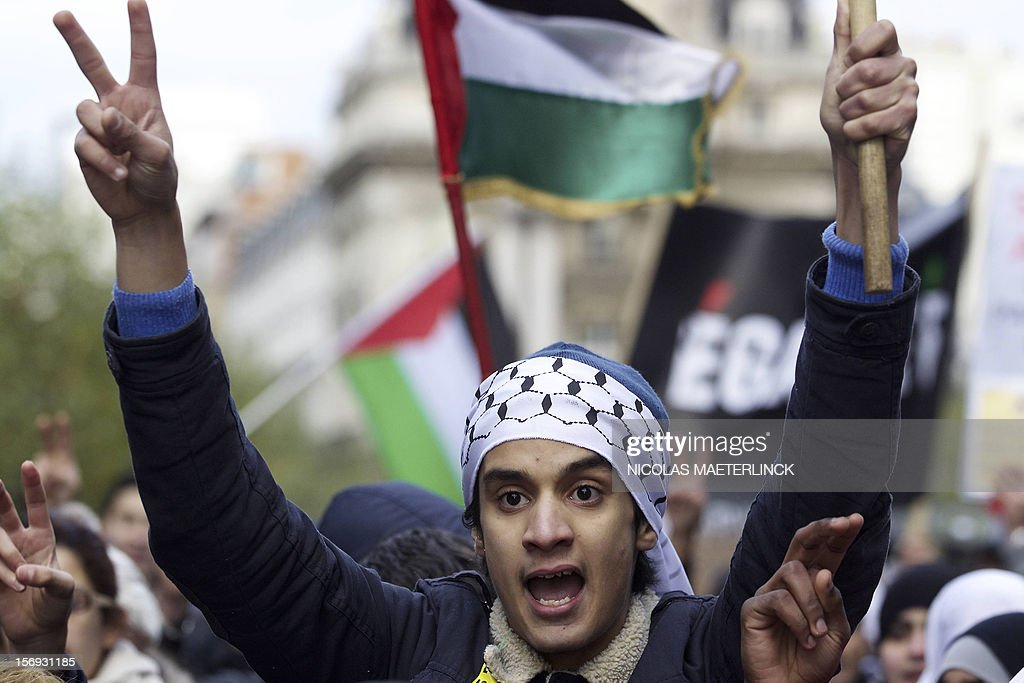 A man flashes a victory sign during a demonstration in solidarity with Palestinians and denouncing recent Israeli bombardments on Gaza, on November 25, 2012, in Brussels.