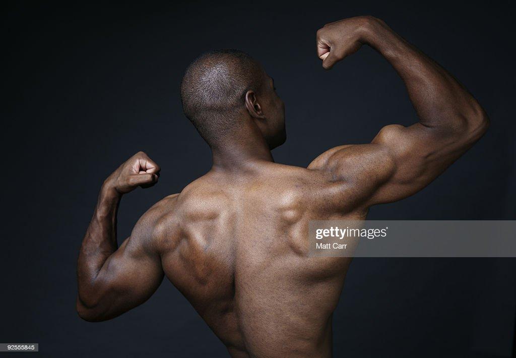 Man flexing muscles : Stock Photo