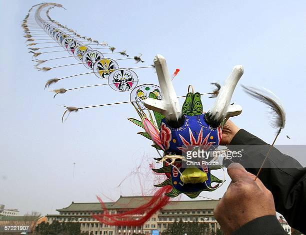 A man flies a dragonshaped kite at a square on March 31 2006 in Changchun of Jilin Province China Chinese people have the tradition of flying kites...