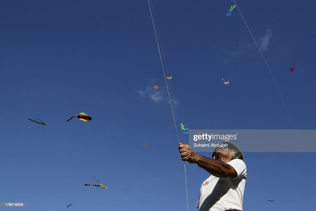 A man flies a kite during the Singapore Kite Festival at the Promontory at Marina Bay on August 31, 2013 in Singapore. Into its fifth edition, the annual two day festival attracts hundreds of kite enthusiast who spend the days flying kites in various locations around Marina Bay.